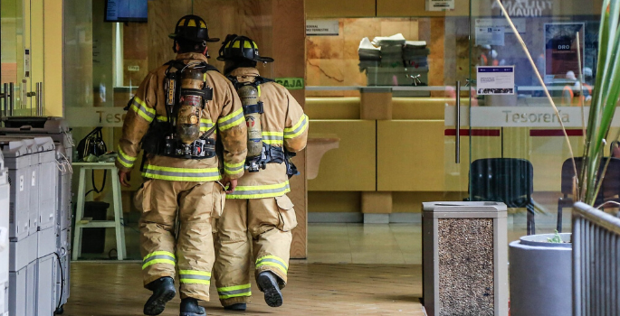 2 Firefighters inspecting a building