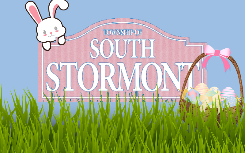 Easter bunny and basket of eggs on grass with Township of South Stormont logo