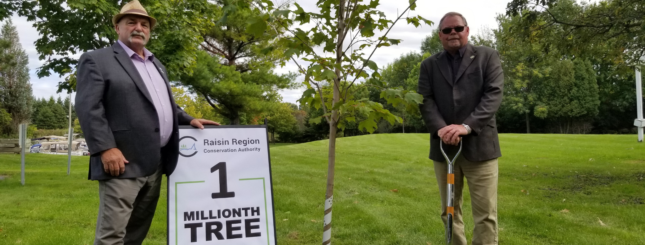 Mayor and Deputy Mayor next to 1 millionth tree planted
